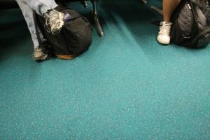 Feet waiting in an airport.