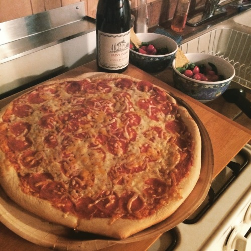 Papa Murphy's Heart Shaped Pizza, and a bottle of really very nice wine. An excellent pairing, especially for a Wes Anderson viewing.